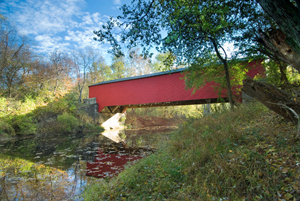The Ramp Creek Covered Bridge at the north entrance of Brown County State Park in Indiana. Photo by Chuck Szmurlo, licensed under the Creative Commons Attribution 3.0 Unported license.