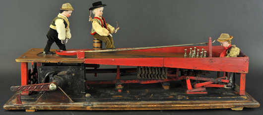 'The Bowlers' automaton, patented 1907 by Otto Eichenburger of Switzerland, multiple actions, bisque-head figures, 42in long. Est. $12,000-$15,000. Bertoia Auctions image.