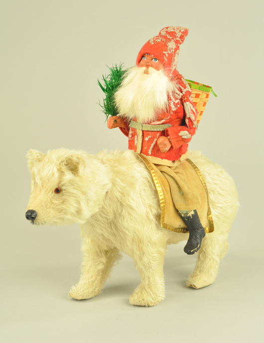 Candy container, glass-eyed white mohair polar bear with Santa rider, 11in high. Est. $3,500-$4,500. Bertoia Auctions image.