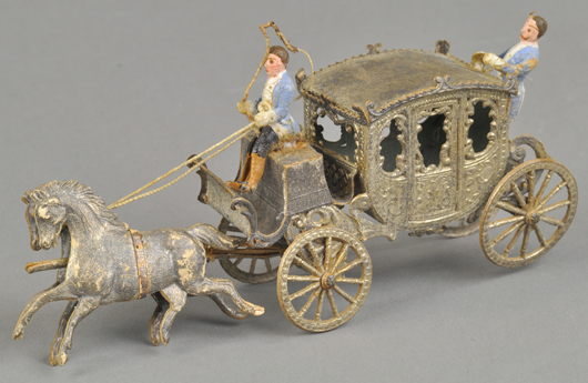 Silver Dresden Christmas ornament replicating a horse-drawn coach, 6in long. Est. $1,800-$2,000. Bertoia Auctions image.
