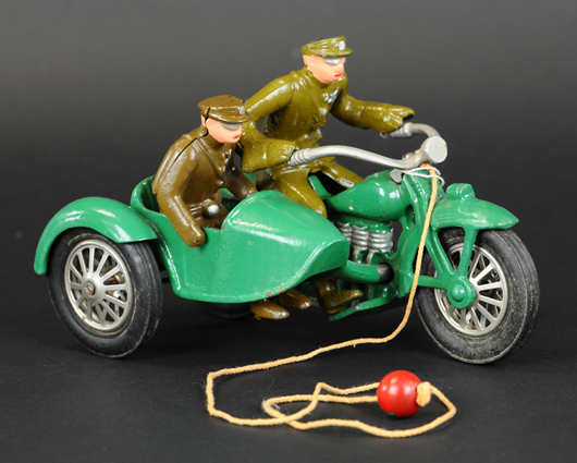 Vindex cast-iron motorcycle and sidecar, production run of less than two years, 8½ in, green with khaki driver and rider. Est. $12,000-$15,000. Bertoia Auctions image.