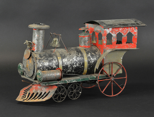 Ives large-scale clockwork locomotive, hand-painted tin with cast-iron spoke wheels, 18in overall length. Est. $6,000-$8,000. Bertoia Auctions image.