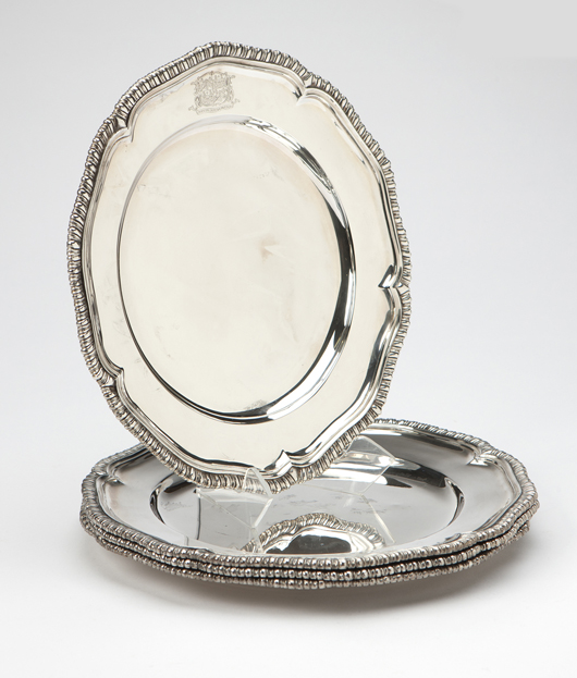 These heavy sterling plates, one of the many lots of Georgian silver, bear the mark of Paul Storr and date to 1808. John Moran Auctioneers image.