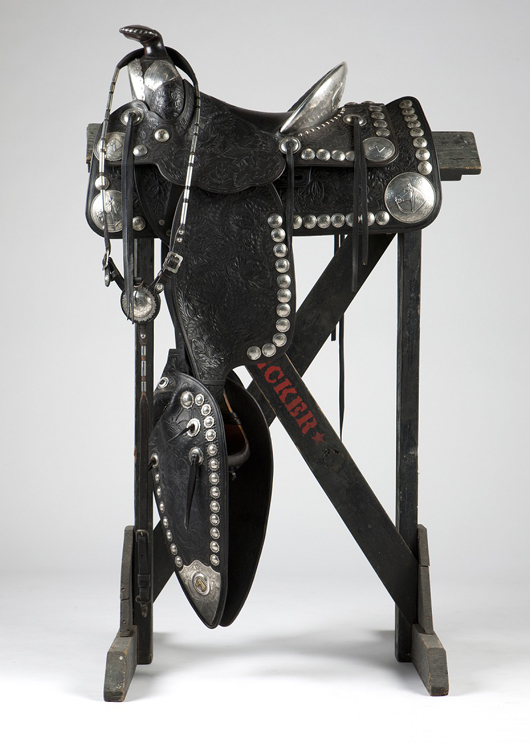 This Visalia Stock Saddle Co. parade saddle, featuring 80 silver conchos decorated with Ranchero Visitadores horse heads, is one of many pieces of high end tack offered from the Bryant estate (estimate: $3,500 to $5,500). John Moran Auctioneers image.
