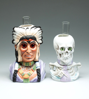 Ceramic figural miniature lamps including a rare American Indian chief from the Hulsebus collection. Jeffrey S. Evans & Associates image.