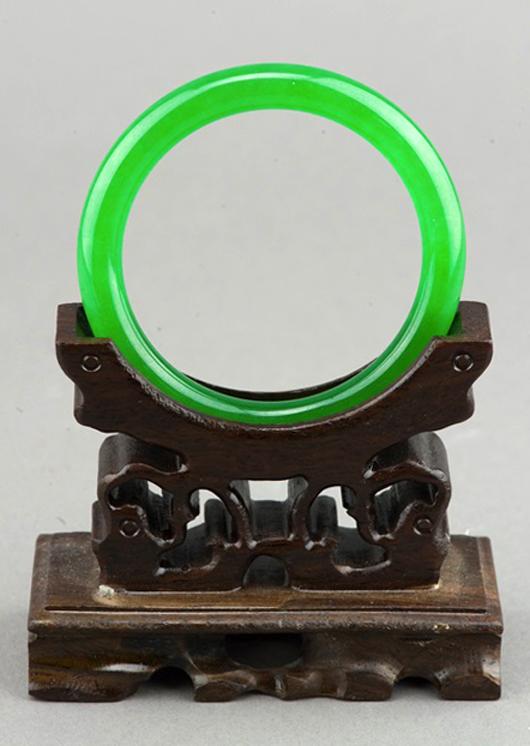 Lot 177: important Chinese emerald green jadeite bangle. Estimate: $6,000-$8,000. 888 Auctions image.