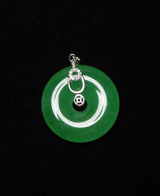Lot 309: icy emerald green jadeite pendant with clear stones. Estimate: $1,000-$2,000. 888 Auctions image.