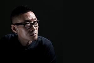Portrait of artist Wang Jianwei in his studio, Beijing, 2013. Photo: Xiao Mi. Courtesy the artist.