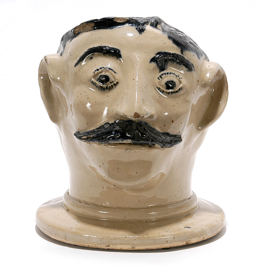 Anonymous stoneware bust, circa 1850-1900. 7.5 inches high. This figure was probably the lid for a crock, jar or churn. Estimate: $3,000-5,000. Slotin Auction imge.