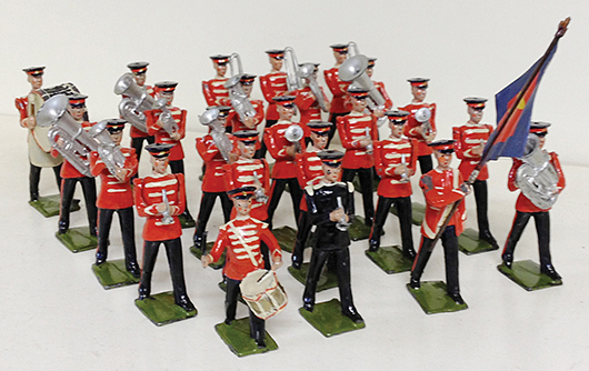 Near-mint Britains Set 1317 Salvation Army Band set in red tunics. Est. $6,000-$8,000. Old Toy Soldier Auctions image.