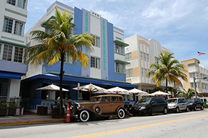 Art Deco-inspired architecture on Ocean Drive in Miami Beach, Florida, home to Art Basel. Photo by Massimo Catarinella, licensed under the Creative Commons Attribution-Share Alike 3.0 Unported license.