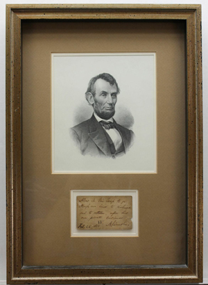 Engraved portrait of Abraham Lincoln framed together with 1865 handwritten note in authorizing passage through Union lines toward Richmond. Est. $3,500-$4,500. Waverly's image.