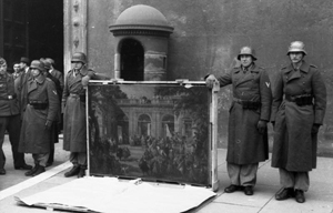 German soldiers of the Hermann Göring Division posing in front of Palazzo Venezia in Rome in 1944 with a picture taken from a local museum. This file is licensed under the Creative Commons Attribution-Share Alike 3.0 Germany license.