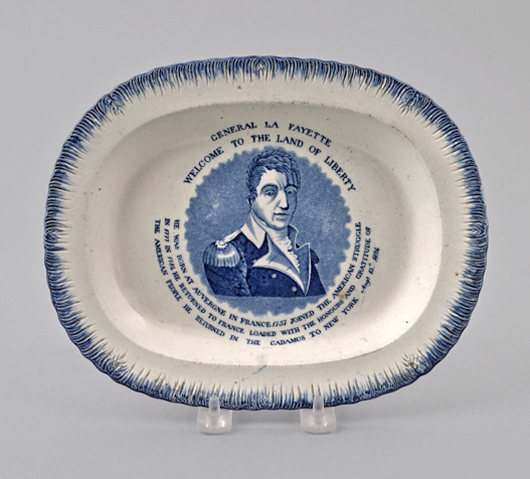 A true souvenir plate, this feather edge platter with printed portrait at center celebrates the 1824 visit of Revolutionary War hero General Lafayette and brought a final price of $6,518 (est. $3,000-$5,000). Courtesy Pook & Pook.
