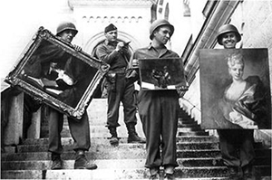 A photo in the U.S. National Archives shows U.S. troops recovering looted paintings from Neuschwanstein Castle in Germany during World War II. Image courtesy of Wikimedia Commons.