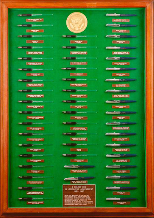 Framed collection of 50 pens used by Presidents JFK and LBJ to sign bills. John McInnis Auctioneers image.