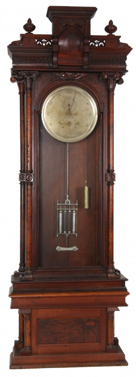 Astronomical regulator attributed to the U.S. Clock Co., in a large carved walnut case, 112 inches tall (est. $15,000-$30,000). Fontaine's Auction Gallery image.
