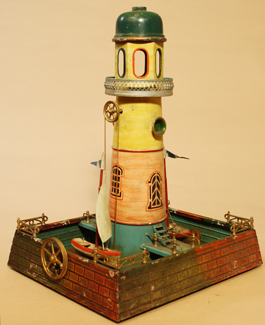 Doll et Cie steam-accessory lighthouse, 15in high, hand-painted, French. Est. $6,000-$9,000. RSL Auctions image.