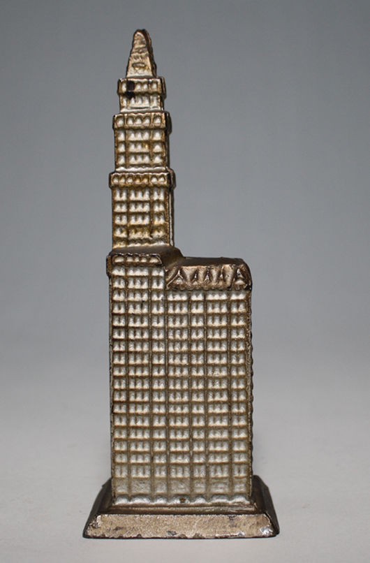 Kenton Hardware Woolworth Building cast-iron still bank on base. Provenance: Donal Markey collection. Est. $6,500-$8,500. RSL Auctions image.