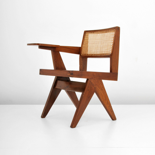 Pierre Jeanneret (French) writing chair, wood with caning, est. $2,000-$2,500. Palm Beach Modern Auctions image.