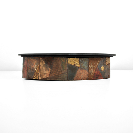 Paul Evans (American) brutalist cocktail table, mixed metals and slate, est. $5,000-$7,000. Palm Beach Modern Auctions image.