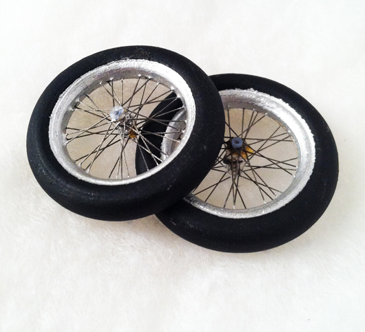 From 'E.T. The Extra-Terrestrial,' miniature bike wheels from the sequence when the boys fly their bikes across the night sky. The effect was done with miniatures, utilizing stop motion control. These wheels were given to an ILM special effects artist by miniature special effects 'E.T.' supervisor Ease Owyeung. Premiere Props image.