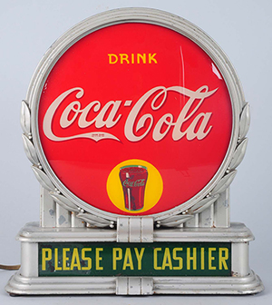 1932 Coca-Cola illuminating counter sign manufactured by Brunhoff, 14in, est. $4,500-$7,500. Morphy Auctions image.