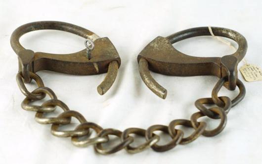 Sheriff Eugene Kay's leg irons used on Grat Dalton following the Feb. 6, 1891, train robbery in Alila, Calif. Estimate: $2,000-$3,500. California Auctioneers image.