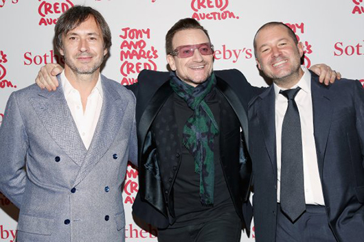 (L-R) Marc Newson, Bono and Jony Ive attend Jony And Marc's (RED) Auction at Sotheby's on November 23, 2013 in New York City. Photo by Cindy Ord/Getty Images for (RED).