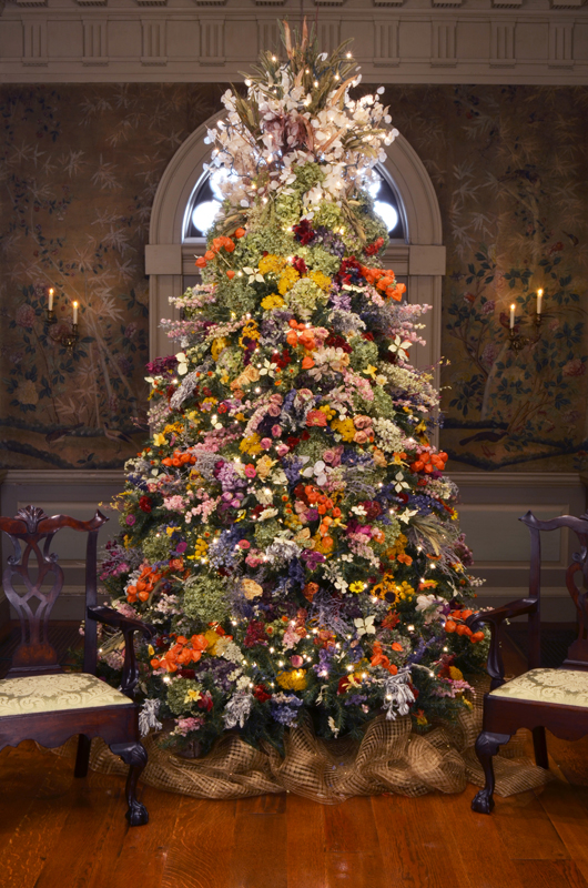 The famed Winterthur Dried Flower Tree's first appearance was in 1978, the same year of the first Yuletide at Winterthur. It has been part of Winterthur's Christmas theme ever since, with decorations that change every year. Many visitors come to Winterthur especially to see this tree. Image courtesy of Winterthur.
