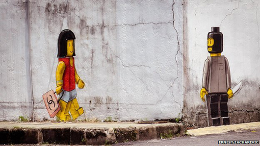 This photo of Ernest Zacharevic's mural in Singapore was widely shared through social media before authorities ordered the artwork to be painted over. Image courtesy of Ernest Zacharevic.