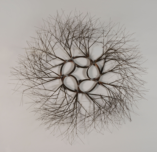Ruth Lanier Asawa (Californian 1926-2013) Wire Sculpture, tied wire branching wall mounted wreath Estimate:  $80,000 / 90,000. Image courtesy of Michaan's.