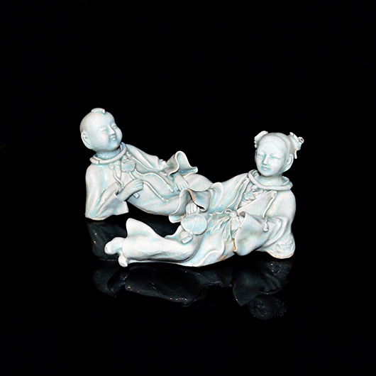 Rare Qingbai figure of Fairchild fairies glazed in a transparent pale blue tone, naturalistically rendered with a  serene expression, Song Dynasty. Estimate: $4,000- $5,000. Gianguan Auctions image.