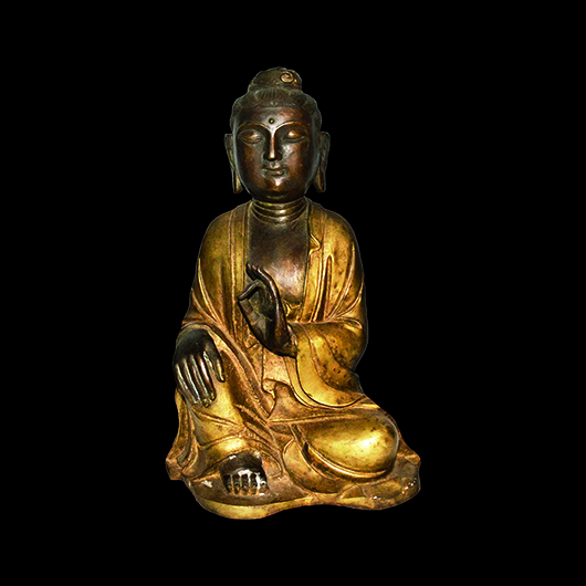 Gilt Guanyin cast as serene deity broad face with downcast eyes, hands in dhyanasana, with ruyi chignon, dressed in loose flowing robes. Qing Dynasty. Estimate: $8,000-$10,000. Gianguan Auctions image.
