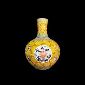 Famille Rose enamel yellow ground floral Shou vase, Qing Dynasty. Estimate: $800,000-$1,200,000. Gianguan Auctions image.