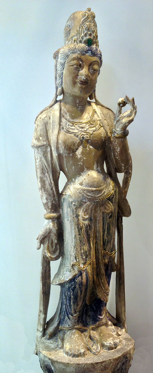 A Guanyin female figure in wood and gesso that sold for £800 on the stand of A.B. Antico at the Antiques for Everyone Fair in November. Image courtesy Antiques For Everyone Fair.