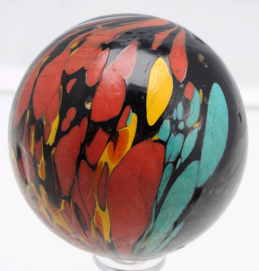 Rare maglight Indian marble with spotting and colors reminiscent of end-of-the-day glass, 2-3/8in dia. Est. $7,000-$10,000. Morphy Auctions image.