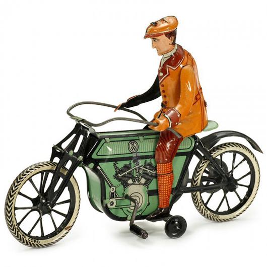Tin motorcycle by William Krauss of Nuremberg made 9,200 euros ($12,500). Auction Team Breker image.