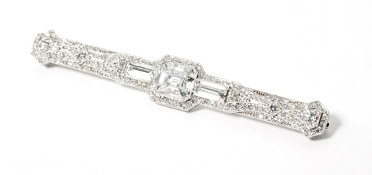This Art Deco diamond and platinum brooch mounted with a 1.98-carat diamond is one of many Art Deco jewels that John Moran Auctioneers will offer in their Dec. 10 Jewelry and Luxury Auction. John Moran Auctioneers image.