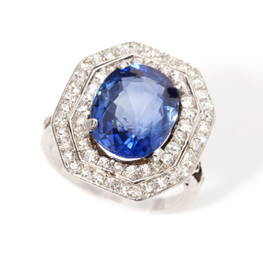 Estimated at $6,000-$8,000 is this platinum ring mounted with diamonds and a 6.80-carat oval-shape Burmese sapphire that is certified to show no signs of heat or clarity enhancement. John Moran Auctioneers image.