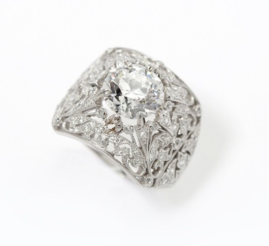 The diamond centering this Edwardian platinum ring is a round brilliant graded G color and measuring 2.12 carats. Estimate: $15,000-$20,000. John Moran Auctioneers image.