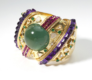 Amethyst, ruby and emerald cabochons make a colorful statement on this large Lola Demner bangle that Moran's is offering for $6,000-$8,000. John Moran Auctioneers image.