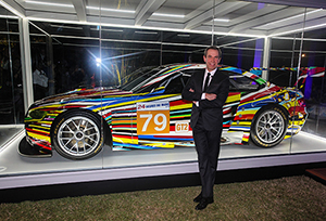 Jeff Koons and his Art Car. Image courtesy of BMW.