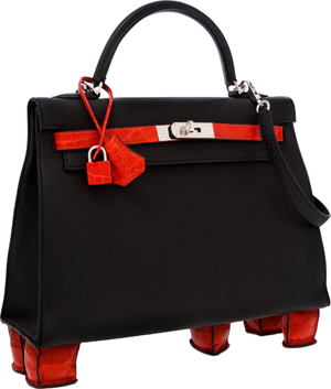 Hermes one-of-a-kind 32cm Matte Geranium Porosus Crocodile and Black Togo Leather Sellier Kelly Bag with feet. Estimate $50,000-$100,000. Heritage Auctions image.