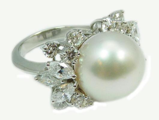 Exquisite Cartier platinum ring featuring a large South Seas pearl, size 6 1/2. Estimate: $20,000-$30,000. Elite Decorative Arts image.