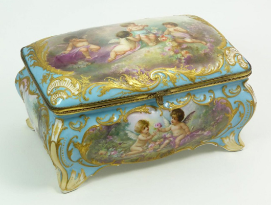 Antique Sevres French porcelain box depicting cherubs in forest scenes with flowers. Estimate: $5,000-$7,000. Elite Decorative Arts image.