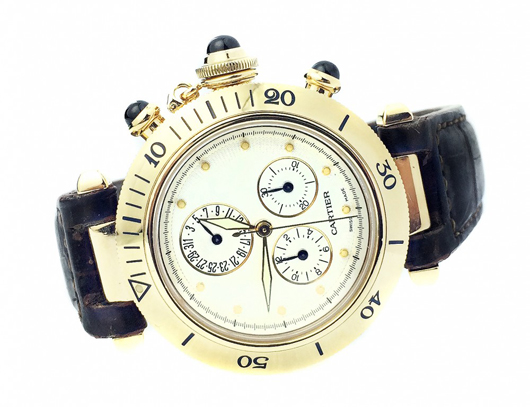 Cartier 'Pasha' 18K gold Swiss chronograph wristwatch with case, dial and buckle all signed Cartier. Estimate: $8,000-$12,000. A.B. Levy's image.