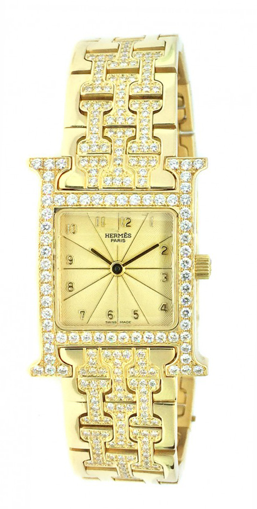 Hermes diamond and 18K yellow gold wristwatch with champagne dial and diamonds set in bezel and bracelet. Estimate: $12,000-$18,000. A.B. Levy's image.
