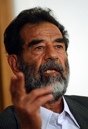 Saddam Hussein at a pretrial hearing. U.S. Department of Defense photo, courtesy of Wikimedia Commons.