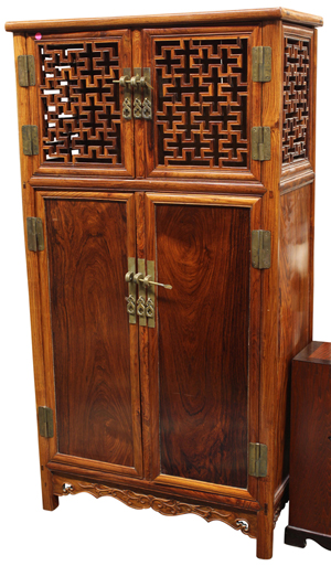This Chinese wooden cabinet featuring a pair of openwork lattice double doors was expected to sell for $450 but earned an astounding $41,650. Clars Auction Gallery image.